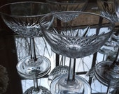Collection of vintage coup and champagne glasses. Bar cart