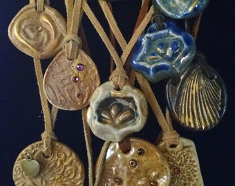 13 Niborogama Fired Pottery Necklaces to choose from