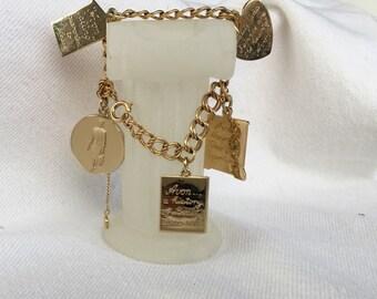 Vintage AVON charm bracelet 1965 President's Award locket puffy heart rep door
