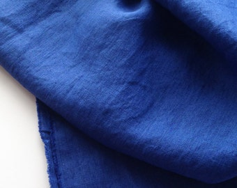 japanese pure linen fabric. medium weight. rudeback half worn out look. 110cm (43in) wide. sold by 50cm (19in) long / half yard. clear blue