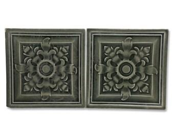 Pair of dark gray ceramic wall tile