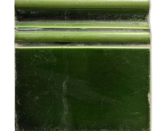 Dark green floor trim tile