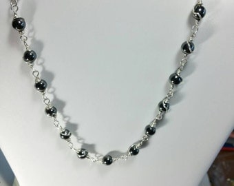 Sterling silver wire wrapped hematite beaded necklace.
