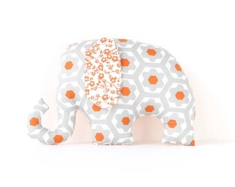 Elephant soft toy / plush toy for baby in grey and orange pattern.