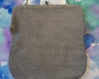 Silver and satin, kiss-lock, vintage evening bag.
