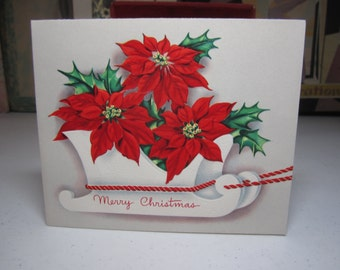 Colorful unused embossed mid century 1950's A Sunshine christmas card deer decorated w/ holly berry pulls white sleigh filled w/ poinsettias