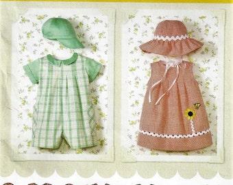 Simplicity 4243 Easy to Sew Babies Infants Wardrobe Sewing Pattern Front Tuck Romper Dress Cap Hat Panties XXS XS S M L  UncutFactory Folded