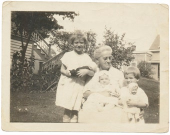 Babies with Baby Dolls holding Baby Dolls snapshot portrait vernacular photography found photo social realism