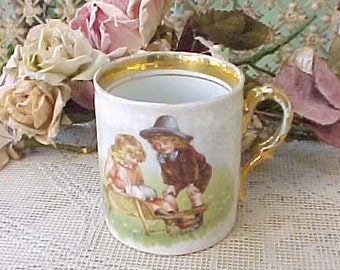 Adorable Victorian Era Child's Porcelain Mug with Children with Bunnies