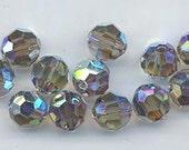 Twelve Swarovski crystals with a rare double AB flash - Art. 5000 - 8 mm - black diamond AB 2X