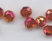 Twelve Swarovski crystals: art 5000 - 8 mm - effect color astral pink