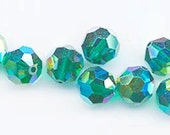 Twelve dazzling limited edition Swarovski crystals: art 5000 - 8 mm - emerald AB 2X