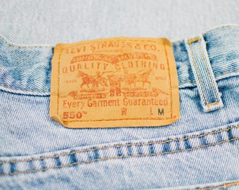 Vintage Levi 550 Jeans >> Tapered Leg High Rise Light Blue Denim >> UK 12 / Euro 40 / US 8 / Waist 30 Leg 31