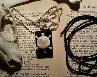 bones.bone doodle. glass pendant. turtle of bones.