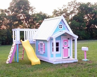 The Residence Playhouse with slide platform by Imagine That Playhouses!
