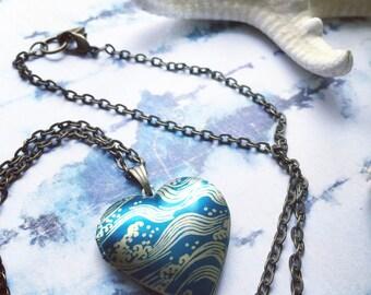 CRASH INTO ME water waves beach heartshaped locket necklace