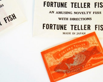 Vintage fortune teller miracle fish in sealed paper envelope