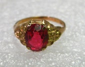1930s Jewelry Styles and Trends Vintage Art Deco 10kt Gold Bright Red 1.25 ctw Spinel Ring size 3 Oval $145.00 AT vintagedancer.com