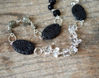 Assymetric stone necklace Crystal quartz nugget necklace Black volcanic lava necklace Long silver chain necklace Raw pyrite Stone jewelry