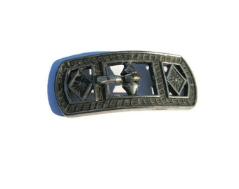 small metal Art Deco buckle for dress or slacks