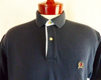 vintage 90's Tommy Hilfiger solid navy blue pique knit polo shirt embroidered griffin crest logo light blue oxford trim oversized medium