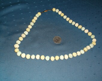 Vintage, Carved and Tinted Bone Necklace, made up of beads which have been hand- carved into Rose shapes.