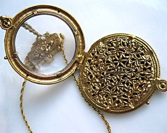 Magnifier Slide Pendant Mirror, Gold Reversible Locket Medallion, Round Flower Disc, Removable Clip Hook, Two Side View, Jewelers Lupe Loupe