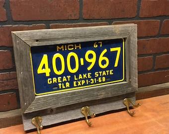 Vintage coat rack - framed license plate -made to order - coat hanger - vintage license plates- real barn wood - vintage brass hooks-