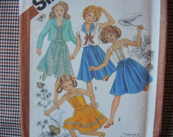 vintage 1980s Simplicity sewing pattern 5468 UNCUT  girls pullover sundress and unlined jacket size 14