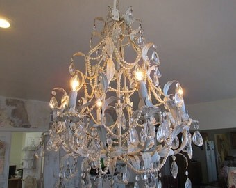 Large ornate chandelier lighting French blue white distressed ceiling fixture embellished w/ crystals pearl necklaces anita spero design