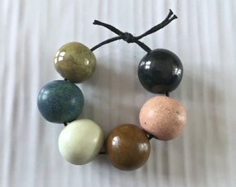 Porcelain bead set, stoneware rounds set