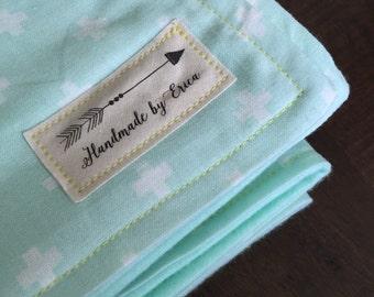 Mint flannel cross baby blanket