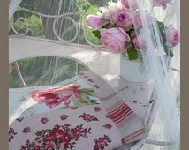 2 coordinated fabric  way patchwork flowers and stripes tones of pink and red  armchair cushion bags Cardboard box
