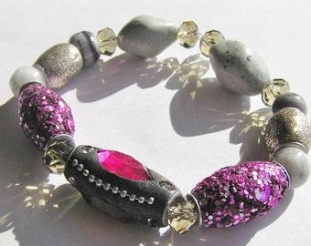 Stretchy Bracelet: Kashmiri Beads, Grey Marble Beads, Khaki Crystal Beads, and Light Grey Ceramic Beads