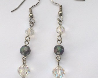 Clear crystal and purple beaded wire dangle earrings