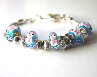 Bracelet made of snow snowmen small glass beads.