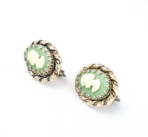 Vintage oval gold tone crown set green and cream colored resin cameo clip on earrings