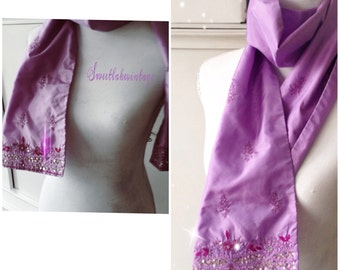 Purple shawl that is embroidered