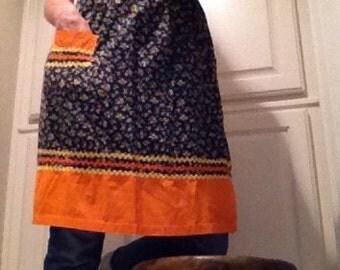Cotton half apron / black floral apron with orange trim rick rack  / half apron with pocket / vintage hostess gift