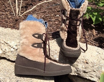 Lace up Eskimo boots with fur snow land brand