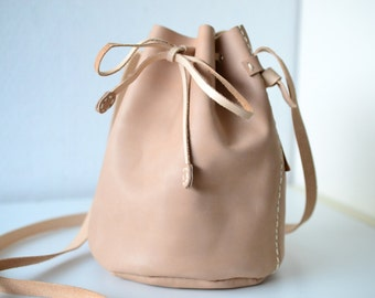 Leather draw string bag, hand stitched round sling bag, Body cross bag.