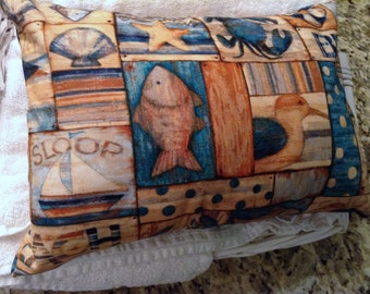 Dream sleep pillow in whimsical ocean beach comber print with removable cover for easy care