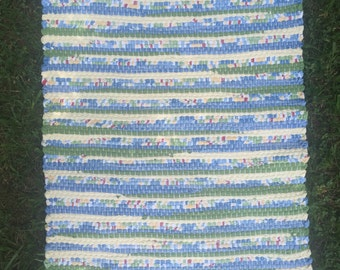 Hand woven rag rug in yellow, green, and blue