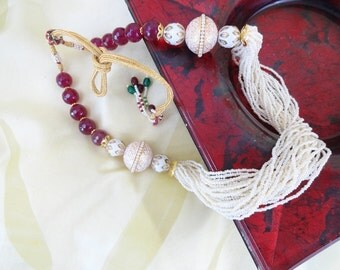 Handmade party wear jewelry from India. Indian Meenakari statement chain necklace. Indian bead and minakari necklace jewelry. . Artikrti.