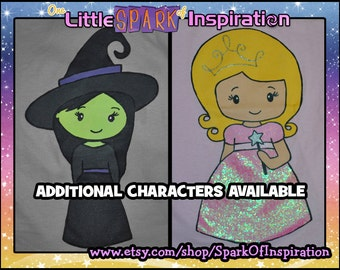 Cuties Collection Wizard of Oz - Glinda Good Witch Elphaba Wicked Witch Dorothoy Scarecrow Tinman Cowardly Lion T-Shirt Commission