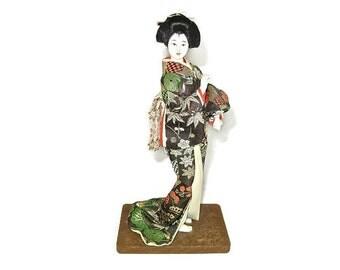 Vintage Japanese GEISHA DOLL FIGURINE Silk Kimono Black Gold Red, Wood Stand, 10 inch