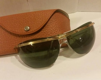 Vintage Sunglasses and Case - curved shield sunglasses green lens