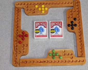 Jokers and Marbles game made from solid Cherry. With bicycle cards, marbles & storage bag. 4 player