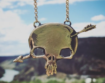 Shakey Graves 'roll the bones' Southwestern Skull Logo Arrow Cut out Brass Handmade Nekclace