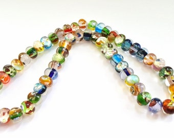 Multicolored Millefiori Flowered Glass Rondelle Beads!!   10 X 7mm in Size.   57 Beautiful Beads.  Great Beads At Great Prices!!